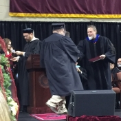 11Middlesboro site graduate Sam Johnson accepts his diploma from Dr. Kraska, Cha