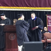 2Corbin campus graduate Michael Strickland accepts his diploma from Dr. Kraska,