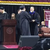 3Corbin campus graduate Timothy Vanzant-Bailey accepts his diploma from Dr. Kras