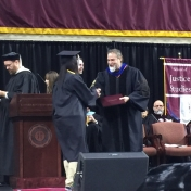 7Danville graduate Page Butler accepts her diploma from Dr. Kraska, Chair, 12-16