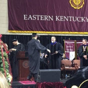 8Manchester campus graduate Madison Reed accepts his diploma from Dr. Kraska, Ch