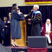 Danielle Fox, Manchester campus accepts her diploma from Dean Ault 12-2014.