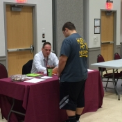 Manchester_Criminal_Justice_Instructor_David_Lawson_explains_the_CJ_program_to_a_student_during_College_Day_11-10-2015.jpg