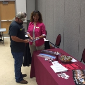 Regional Campus CJ Instructor Carla Lawson speaks with an attendee at the Center for Rural Development Displaced Coal Miner event 7-28-16