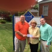 Regional Campuses' APS & LAE student organizations' Mr. Skyler Tylor Mills and Mr. Russell McKay present $250.00 check to Mrs. Mary Schild Director of Sunrise Children Services 5-12-15.  _2