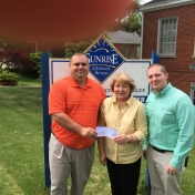 Regional Campuses' APS & LAE student organizations' Mr. Skyler Tylor Mills and Mr. Russell McKay present $250.00 check to Mrs. Mary Schild Director of Sunrise Children Services 5-12-15.